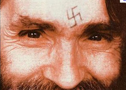 Charles Manson has two unknown tattoo designs, one on each forearm,