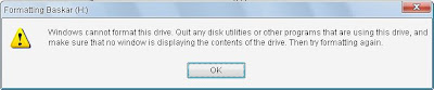 Windows can't format this drive,          Quit any disk  utilities or other programs that are using this drive and          try agian formating