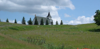 View of St. Peter's on the hill and the road from the Orstad farmhouse below