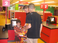 Bryan and Andrew checking out JD's groceries