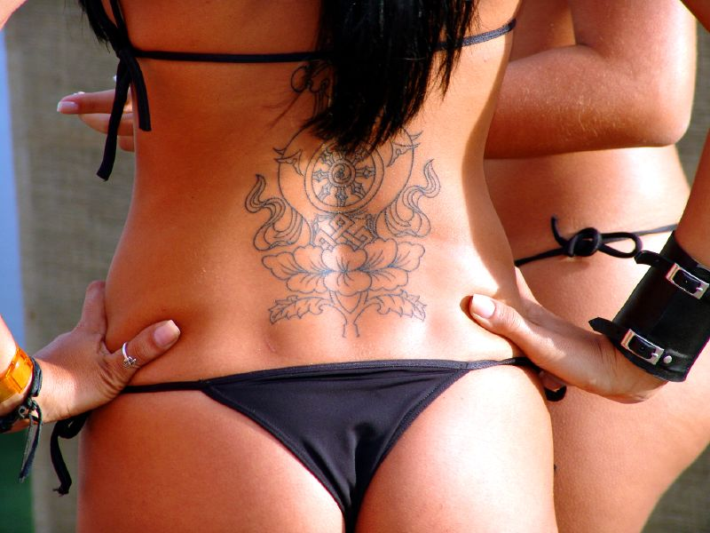 lower back tattoo designs for women. Lower back tattoos