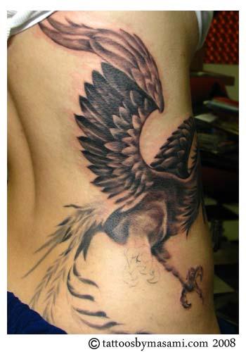 Jacqulynn and her beautiful Phoenix bird tattoo.
