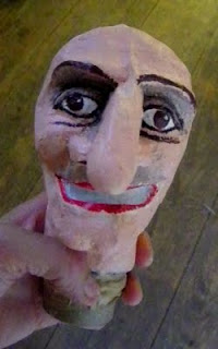 Punch and Judy doll gets painted