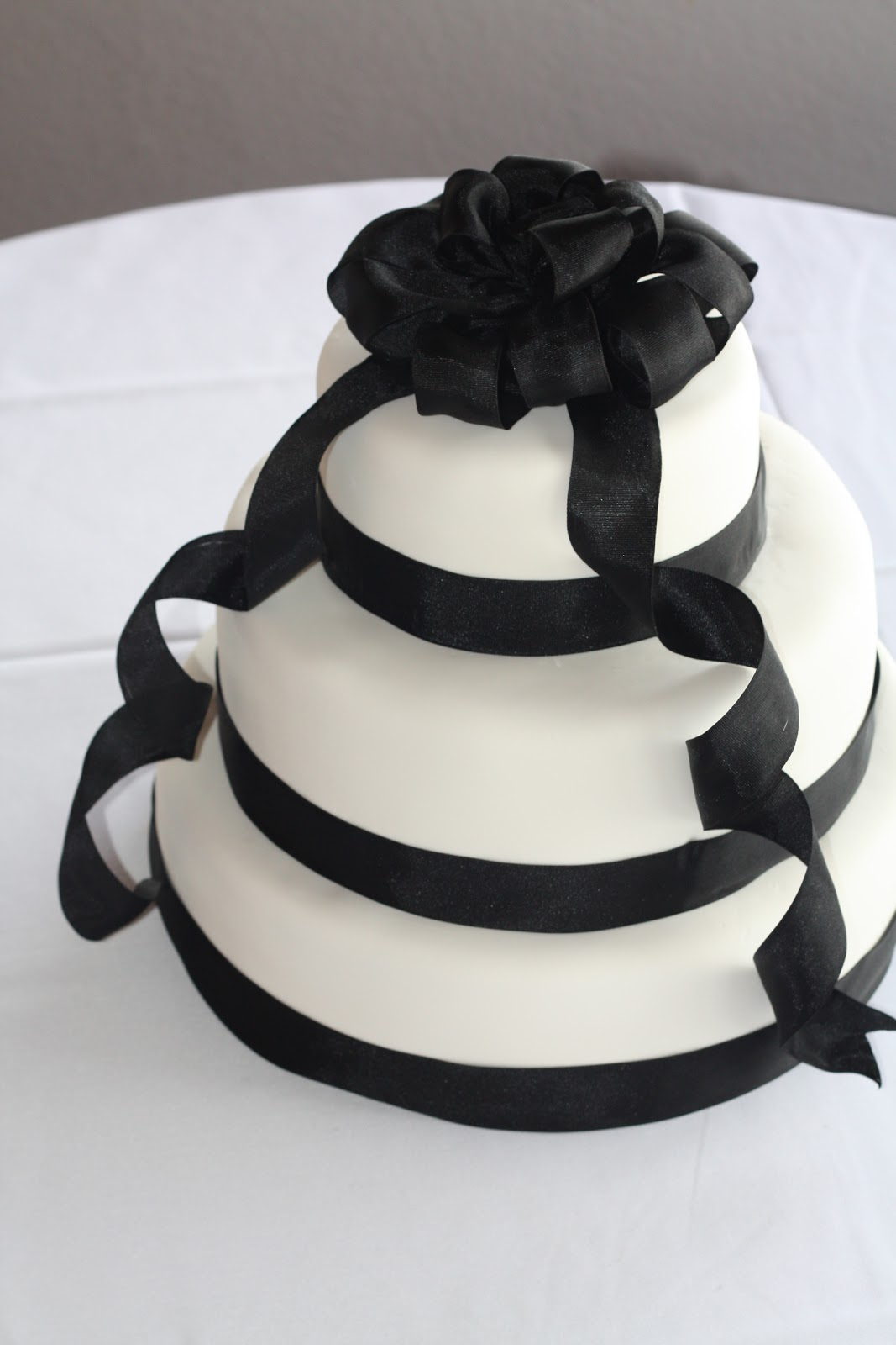 Becca s Blue Bakery Classic Black Ribbon Wedding Cake