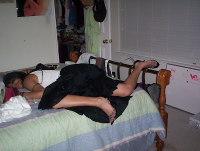 girl ties in skirtsleeping on bed