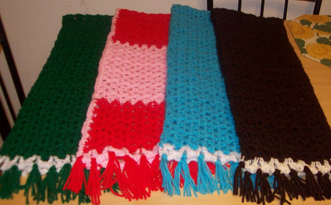 4 scarves finished with tassles!
