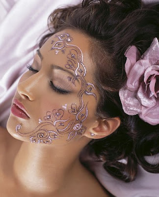 they are the classic paint-on henna designs or modern transfer tattoos,