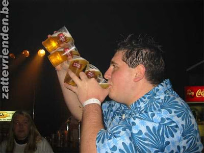Man drinking a fountain of beer out of 5 glasses