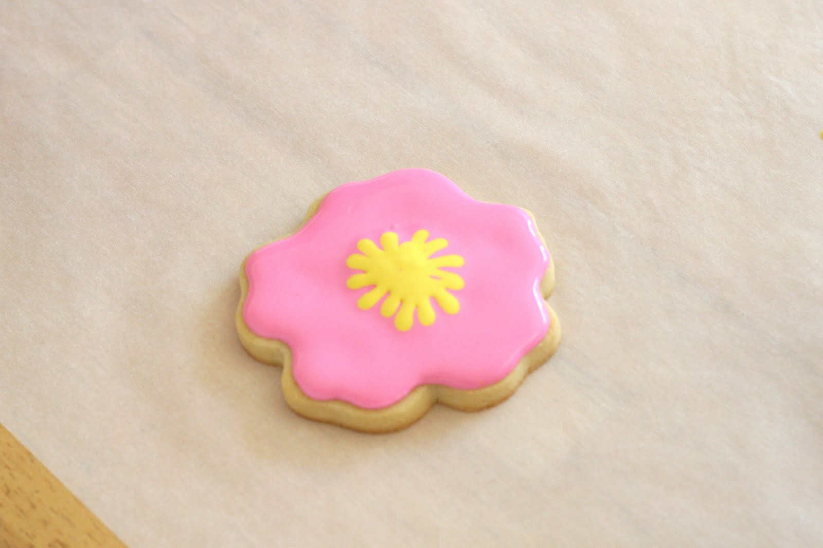 Cookie decorating how to make pretty hibiscus cookies glorious treats drag a tooth pick from the center of the cookie toward the outside but not all the way to the edge izmirmasajfo