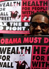 wealth for Wall St vs health for people with AIDS