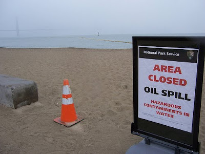 Sign with Area Closed: Oil Spill