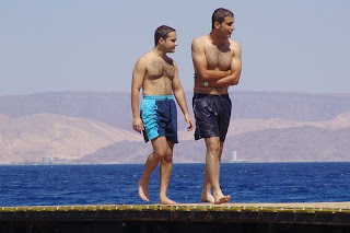 Hunks just out of the water