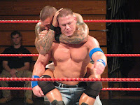 Orton has Cena in a sleeper hold