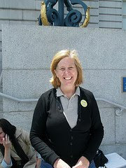 Cindy Sheehan sitting in front of museum