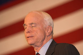 McCain dozing on stage