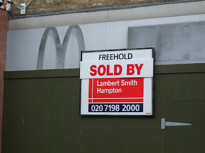 former McDonalds with a Sold sign on it