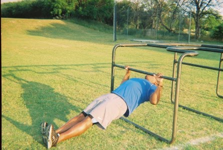 Hang from the bar of a Smith Machine  back to the floor but not    Inverted Row Muscles