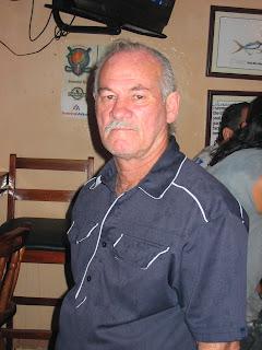 Croc handler in Wacky Wanda's bar in Puerto Quepos Costa Rica