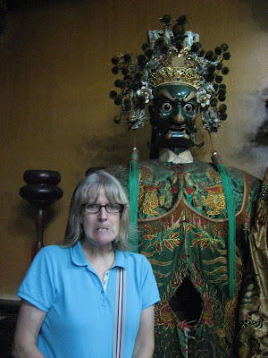 scary face beside God in Tainan City Taiwan