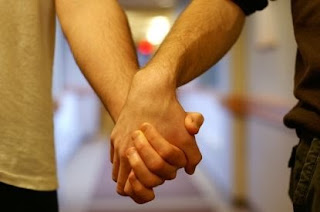 Two guys holding hands on their first date