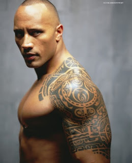 "Dwayne ""The Rock"" Johnson poses with shoulder tattoo."