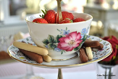 strawberries in a dish topped cake stand