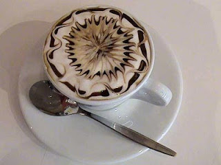 creamy capucino with spiral flower design