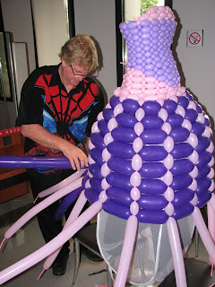 designer setting up balloon wedding dress