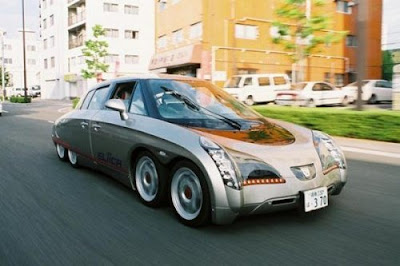 The car's platform contains 4 tracks of 80 batteries, which make for one third of the vehicle's cost. They currently require about 10 hours of recharging from empty to full charge, and can be easily charged off of a residential power grid.