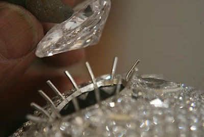close up view how artist placing a diamond