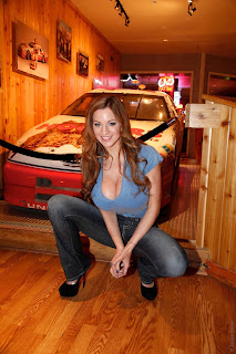 Jordan Carver wears a great blue tight t-shirt and a cool denim blue jeans in Culinary Tour Moment Photoshoot Session at Hooters Restaurant