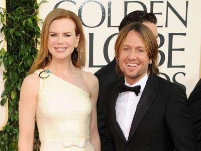 nicole kidman golden globes 2011 dress. Nicole Kidman Dazzles in Cream Prada Gown at 2011 Golden Globe Awards
