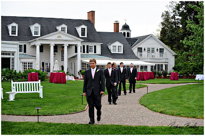 A Fabulous Shot Of The Famous Waterfront Inn And Sharp Looking Groomsmen Processing Down Aisle