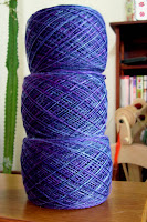 Grape Jelly roving, wound and ready to ply