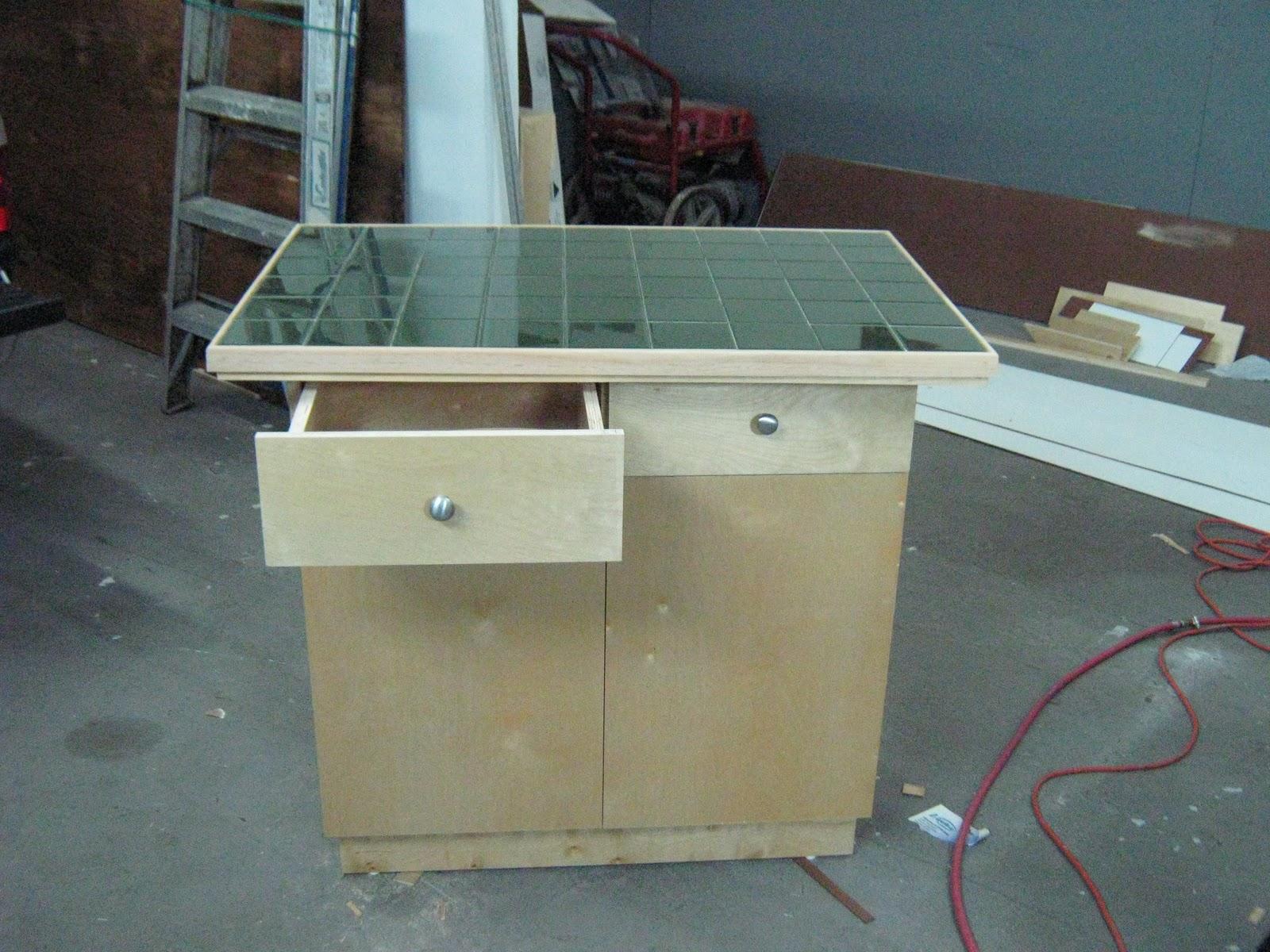Fernandez cabinet isla para cocina en construccion esta for Estufas para islas