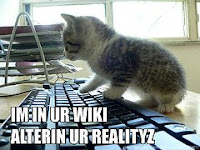 Cat on a computer picture; caption says I'm in your wiki, altering your reality