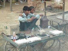 Boys selling eggs