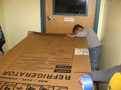 refrigerator box. hiding in the giant refrigerator box: box