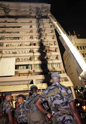 Security forces guard the country's tax headquarters after it was bombed by LTTE in Colombo February 20-2009