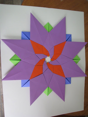 Tomoko Fuse's Origami Quilt Blooming Flowers 1 in Orange, Green, Blue, and Purple reverse side with variation
