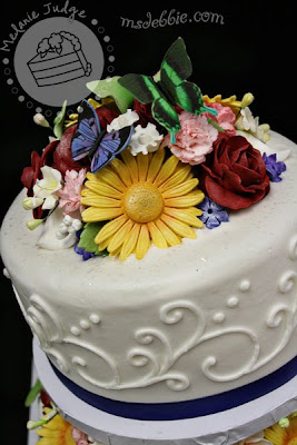 spring flowers cake daisies roses calla lilies buttercream