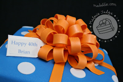 blue orange white gift cake bow