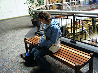 sitting on a bench in the mall, having been guided there by Alfie