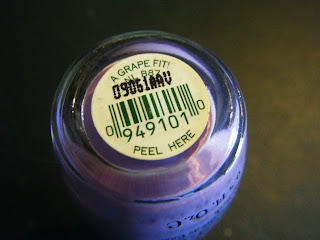closeup of the bottom of the nail polish bottle; it's purple polish, and the title is A Grape Fit