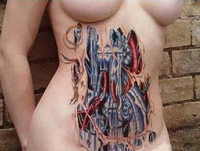 Biomechanical Tattoo on the abdomen