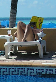 Woman reading Watchmen by the pool