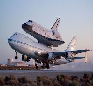 Space shuttle Discovery and its modified 747 carrier aircraft