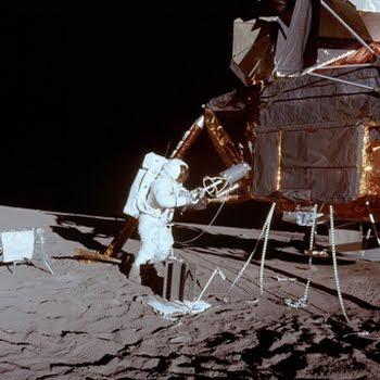 Astronaut Al Bean unloading the plutonium core that powered