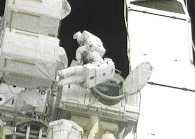 Spacewalkers exit airlock
