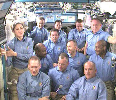The STS-129 and Expedition 21 crew members